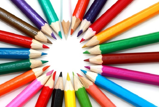 many different coloured pencils form a circle with their points & fan out in bright colours